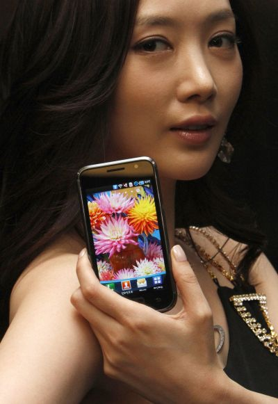 A model poses with the new Samsung smartphone during its launch ceremony.