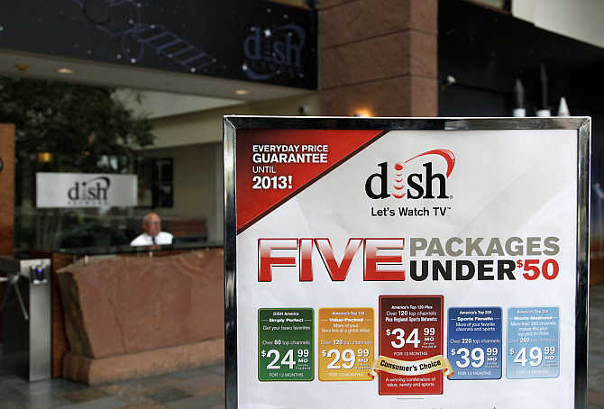 A sign in the lobby of the corporate headquarters of Dish Network shows prices of packages in the Denver suburb of Englewood, Colorado.