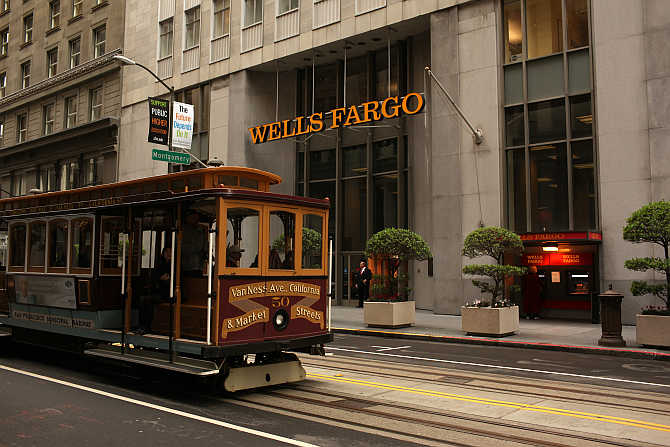 A cable car passes the Wells Fargo Bank headquarters in the Financial District in San Francisco, California.