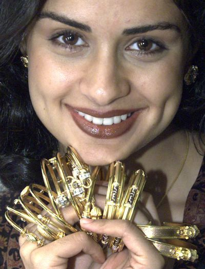 Actor Gul Panag promotes a collection of gold jewellery.