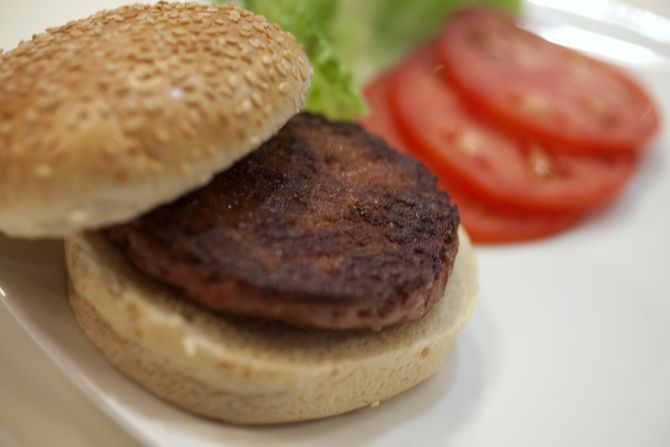 The world's first lab-grown beef burger is seen after it was cooked at a launch event in west London.