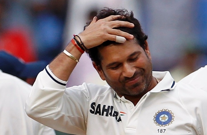 Sachin Tendulkar gestures as he prepares to bowl.