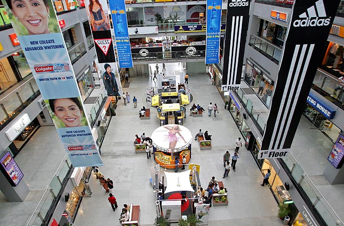 Indian people roam inside a shopping mall during a strike called by the Industrial workers Union and Left parties in Gurgaon.