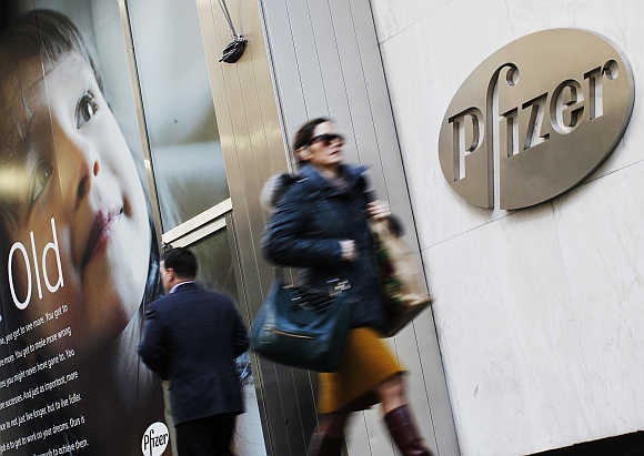 People walk past the Pfizer's headquarters in New York City.