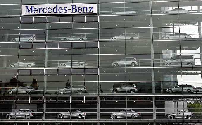 Mercedes-Benz cars, manufactured by Daimler, are displayed in the windows of a dealership of German car manufacturer Daimler in Munich, Germany.