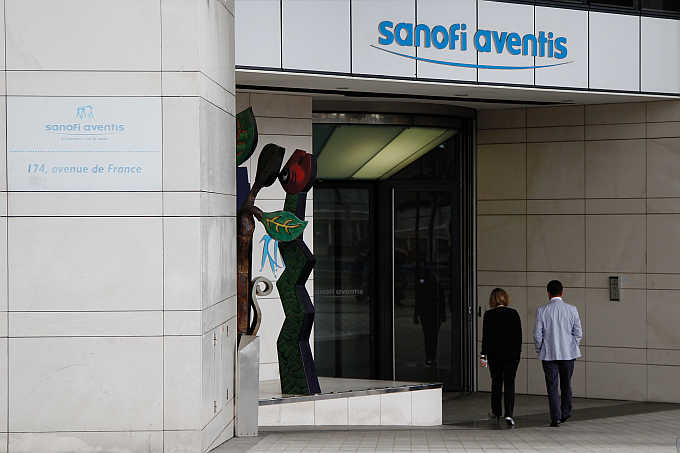Employees enter Sanofi-Aventis headquarters in Paris, France.