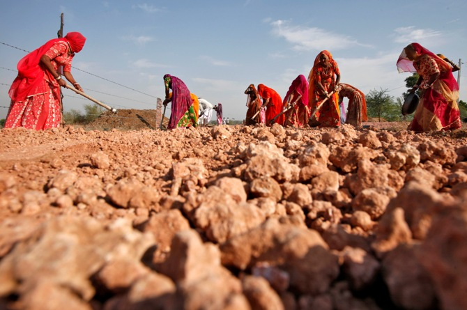 Village women labourers work at the construction site of a road at Merta district, Rajasthan.