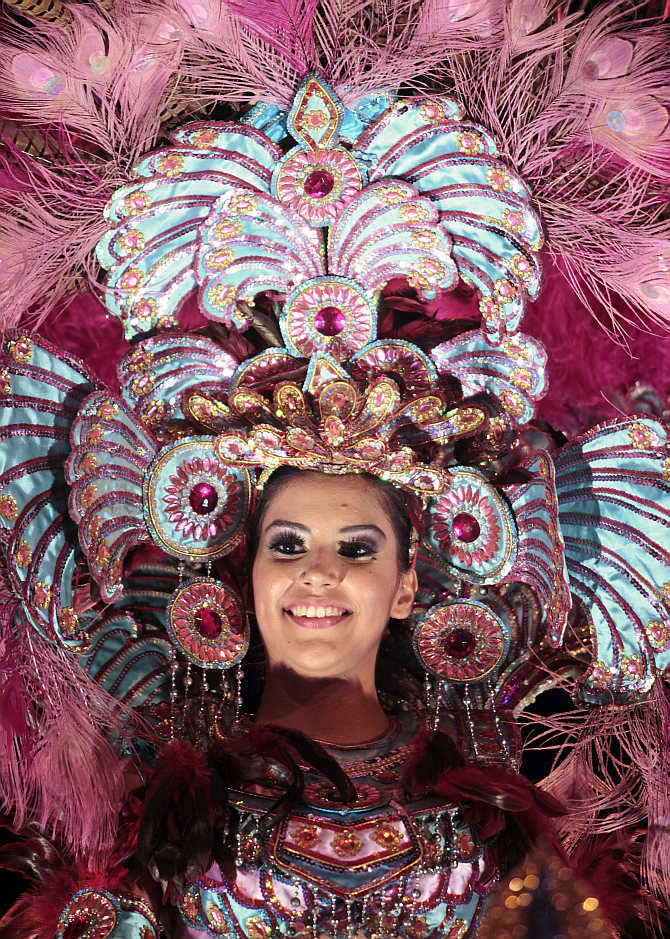 A reveller takes part in the annual carnival in Managua city, Nicaragua.