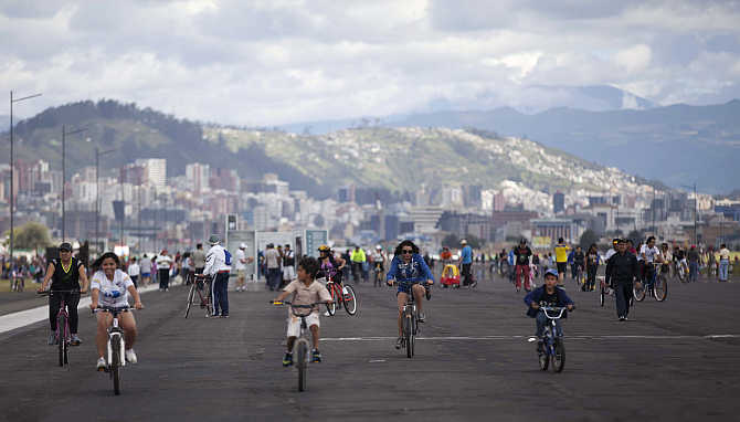 People cycle on the tracks of Quito's Old Mariscal Sucre International Airport in Tababela, Ecuador.