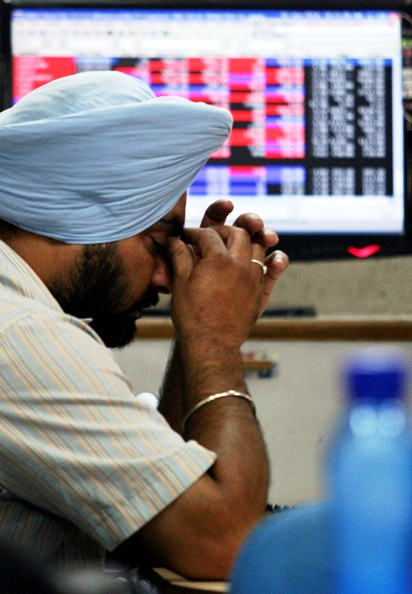 An investor reacts at a local stock market in Chandigarh.