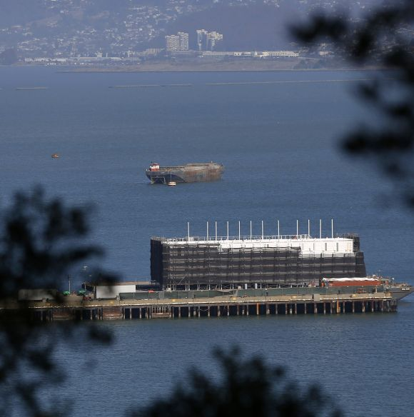 A barge built with four levels of shipping containers is seen at Pier 1 at Treasure Island in San Francisco, California.