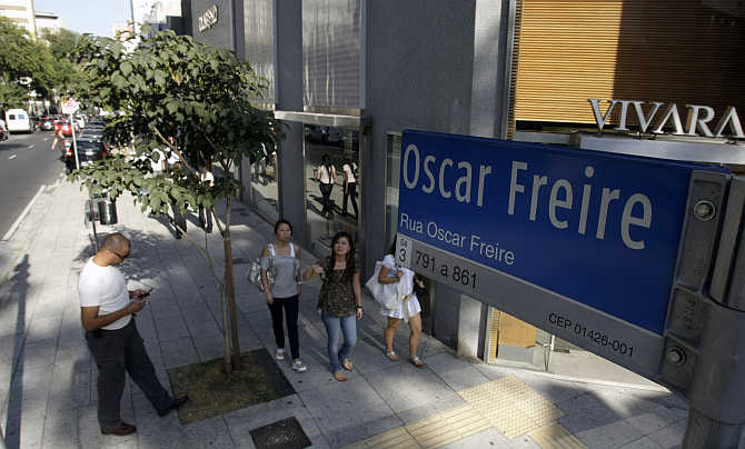 People walk along Oscar Freire street, Sao Paulo's version of Rodeo Drive in Beverly Hills, in Sao Paulo, Brazil.