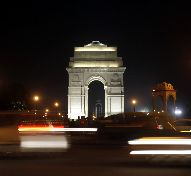 Heavy traffic moves in front of the India Gate before Earth Hour in New Delhi