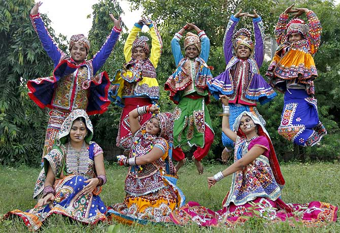 Dancers dressed in traditional attire pose as they take part in rehearsals for the Garba dance ahead of Navratri festival in the western Indian city of Ahmedabad