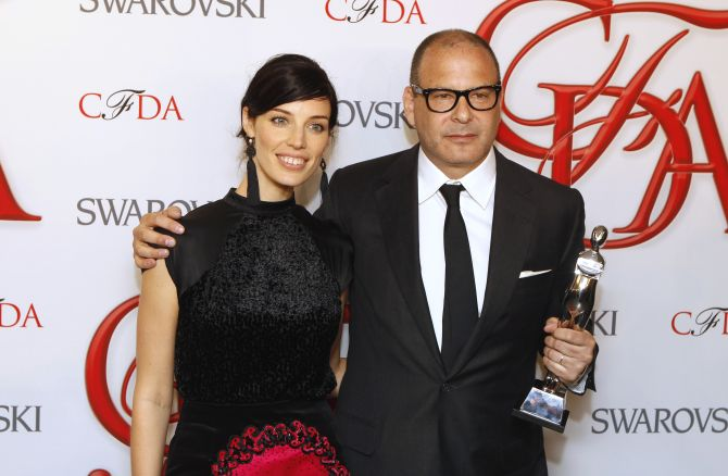 Actress Jessica Pare (L) smiles with designer Reed Krakoff after Krakoff won the award for Accessory Designer of the Year at the 2012 Council of Fashion Designers of America (CFDA) Fashion Awards in New York.