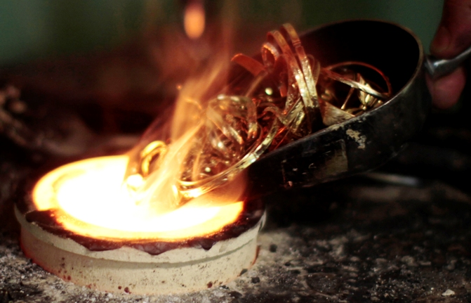 A goldsmith melts down gold jewellery in Los Angeles, California.