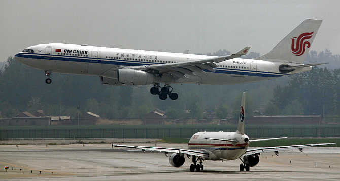 An Air China Airbus A330-243 aeroplane descends to land at Beijing airport, China.