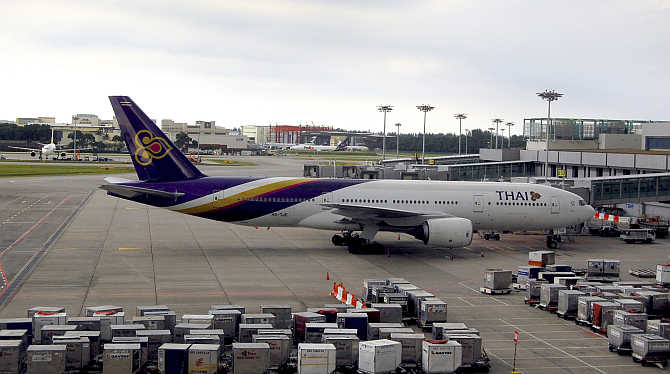 A Thai Airways plane sits on the tarmac at Singapore's Changi Airport.