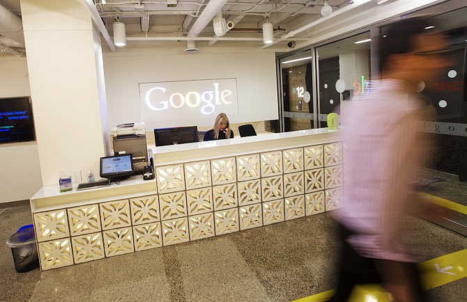 A man walks by the reception desk at the Google office in Toronto, Canada.