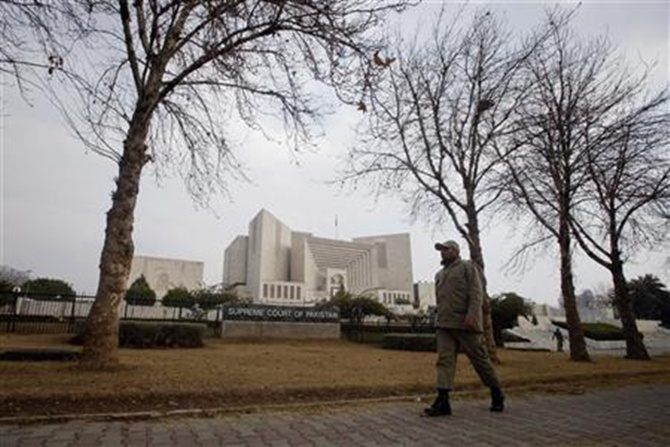 A paramilitary soldier walks past the Supreme Court building in Islamabad