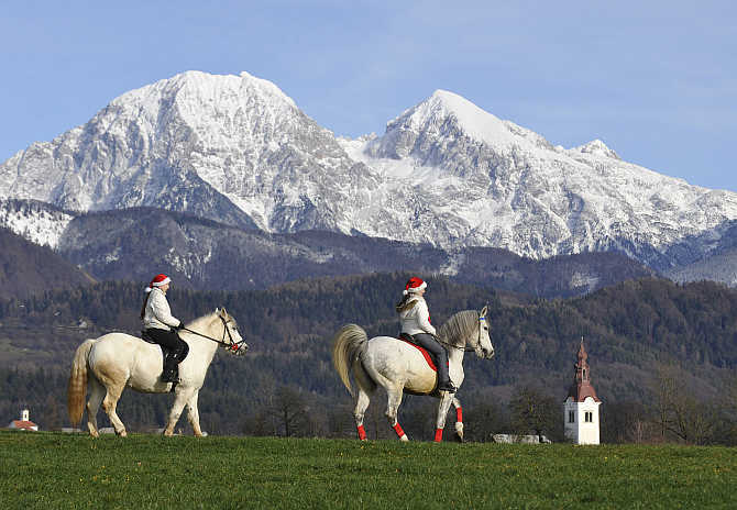 Girls make their way to church for their horses to be blessed by priests on St Stephens day in Srednja Vas, Slovenia.