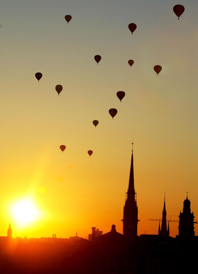 Air balloons sail off into the sunset after participating in a Nordic competition over Stockholm, Salt lake.