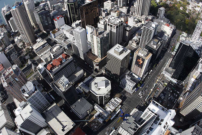 Brad Smith performs a skyjump atop the Sky Tower in Auckland, New Zealand.
