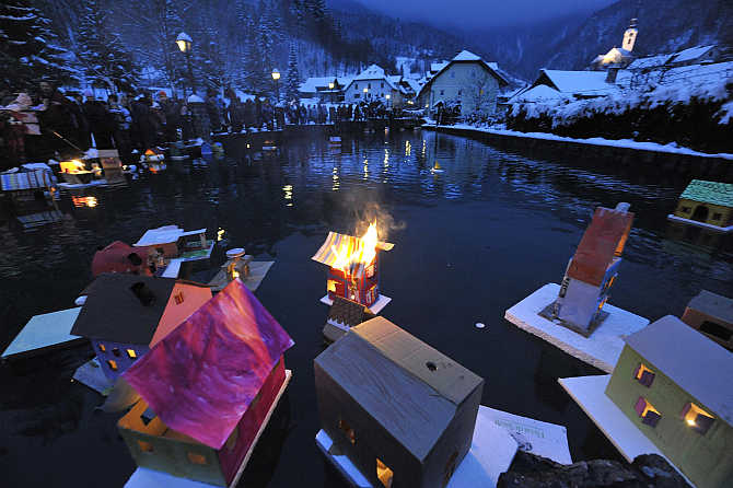 Floats lit with candles are seen as they are released by children on a river in Kropa on St Gregory's Day in Slovenia. The event marks the arrival of spring and symbolises the releasing of light.