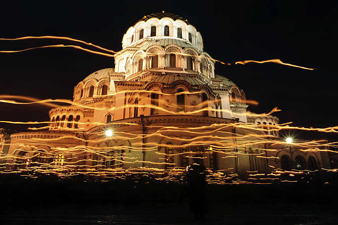 Worshippers walk with candles around the golden-domed Alexander Nevski cathedral during the Orthodox Easter service in Sofia, Bulgaria.