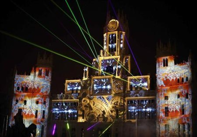 Laser beams and images are projected on the facade of Madrid's city hall during a light show in Madrid.