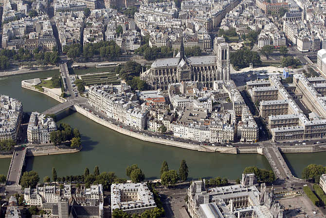 An aerial view shows the Notre-Dame Cathedral on the Ile de la Cite and the Seine River in Paris, France.