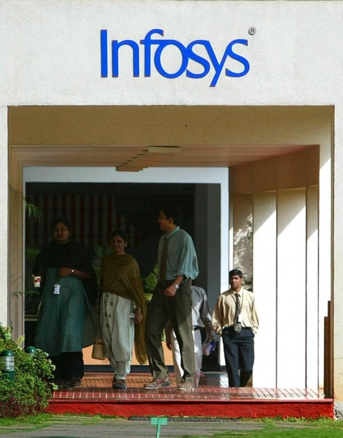 Staff walk in Infosys Technologies campus at Electronics City in Bangalore.