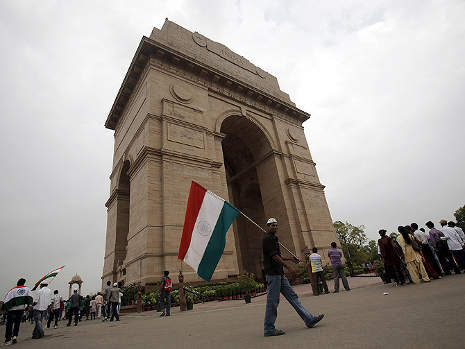 A supporter of veteran Indian social activist Anna Hazare holds India's national flag at the India Gate during a hunger strike by Hazare and his team members in New Delhi.
