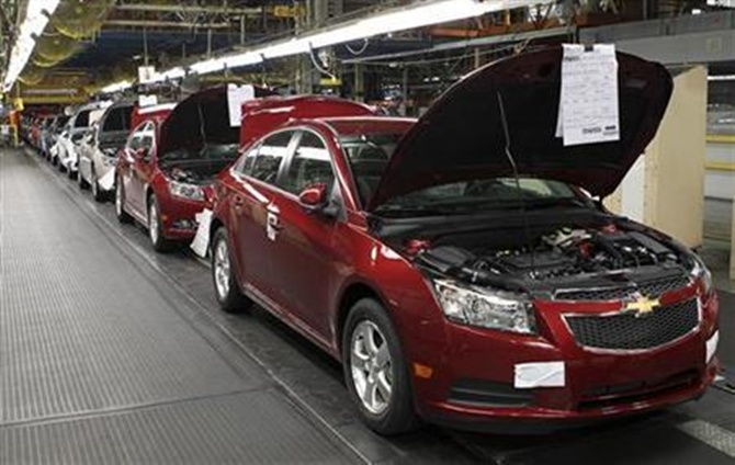 Fully assembled Chevrolet Cruze cars reach the end of the assembly line at the General Motors Cruze assembly plant in Lordstown, Ohio.