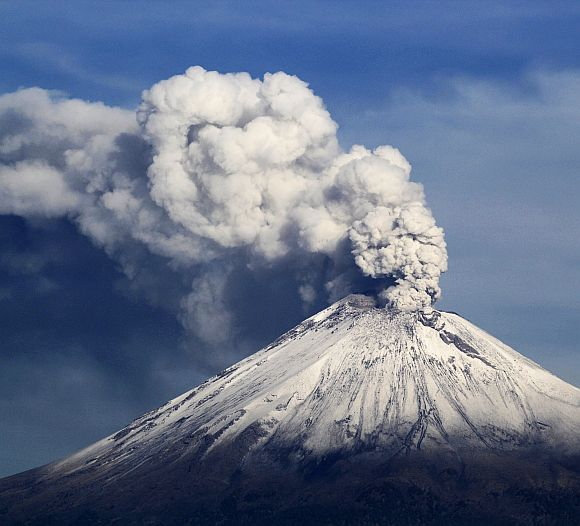A snow-covered Popocatepetl volcano spews a cloud of steam into the air in Puebla, Mexico.