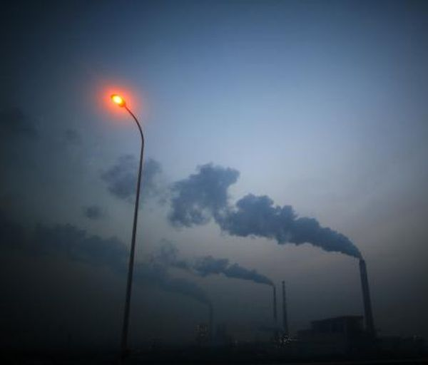 Smoke rises from chimneys of a thermal power plant near Shanghai March 26, 2014.