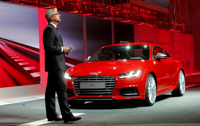 Audi's CEO Rupert Stadler speaks next to an Audi TTS during a Volkswagen Group Night event ahead of the 84th Geneva Motor Show in Geneva late March 3, 2014.