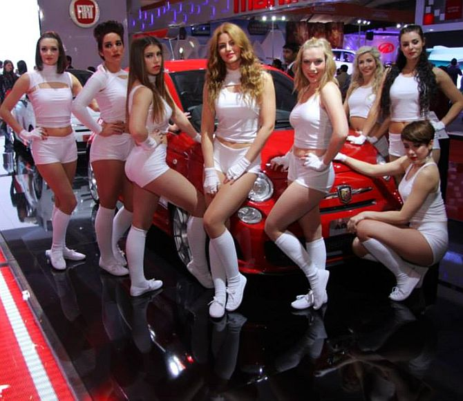 Models surround Fiat's Abarth during the Indian Auto Show.