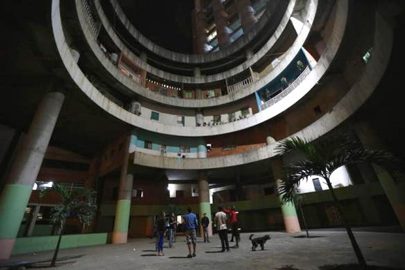 Children play in the lobby of the Tower of David skyscraper in Caracas.