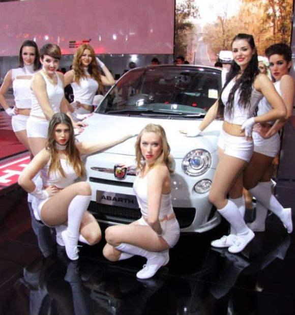 Models surround Fiat Abarth 500 at the Indian Auto Expo.