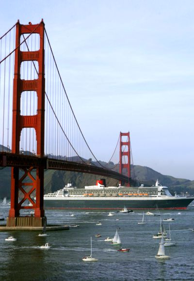 The Queen Mary 2 sails beneath the Golden Gate Bridge as it enters the harbor in San Francisco, California.