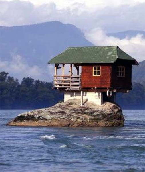 A house built on a rock on the river Drina is seen near the western Serbian town of Bajina Basta, about 160km (99 miles) from the capital Belgrade.