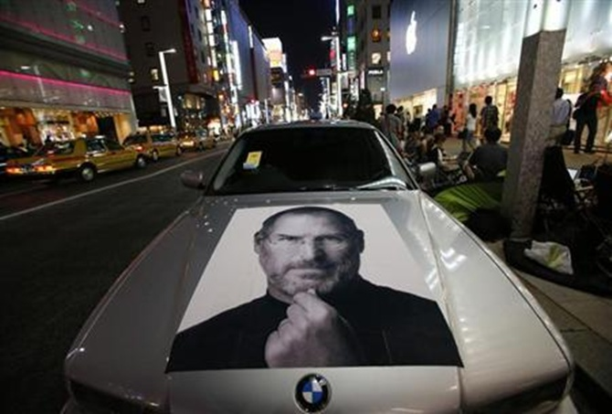 A portrait of Apple co-founder Steve Jobs is seen on a BMW car in Tokyo.