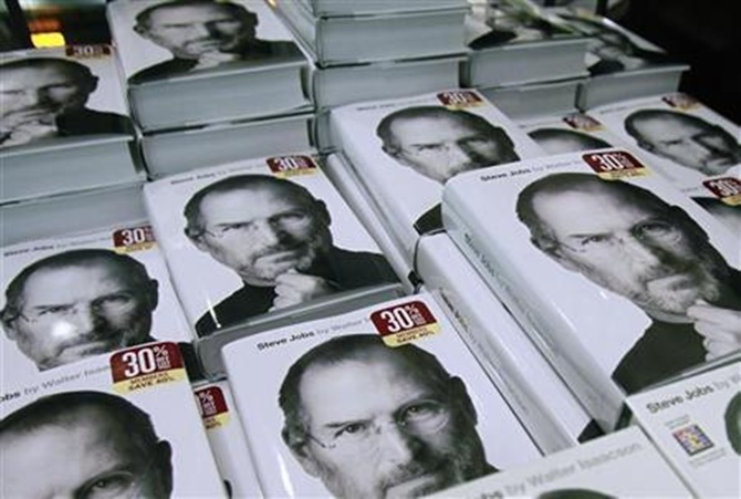 Copies of the new biography of Apple CEO Steve Jobs by Walter Isaacson are displayed at a bookstore in New York .