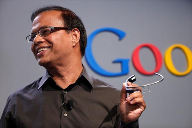 Amit Singhal, senior vice president of search at Google, holds a Google Glass as he speaks at the garage where the company was founded on Google's 15th anniversary in Menlo Park, California September 26, 2013.