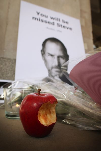 Tributes to Apple Computer co-founder Steve Jobs are placed outside The Apple Store in Covent Garden.