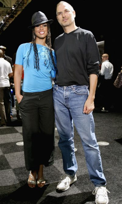 Steve Jobs posing for a photo with R&B singer Alicia Keys during launch of iTunes Music Store.