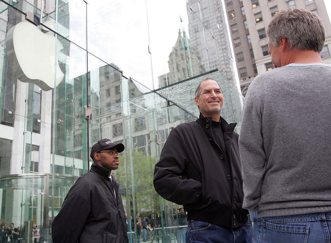 Steve Jobs looking at the crowds at the opening of the an Apple Store on 5th Avenue in New York.