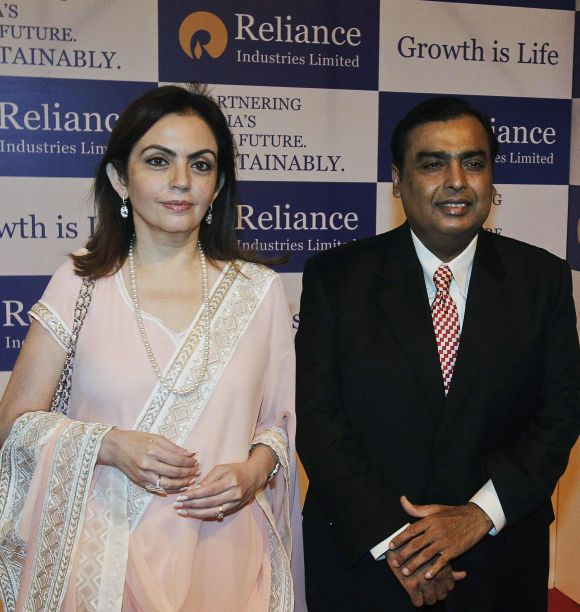 Reliance Industries' Chairman Mukesh Ambani (R) poses with his wife Nita Ambani before addressing the company's annual general meeting in Mumbai.