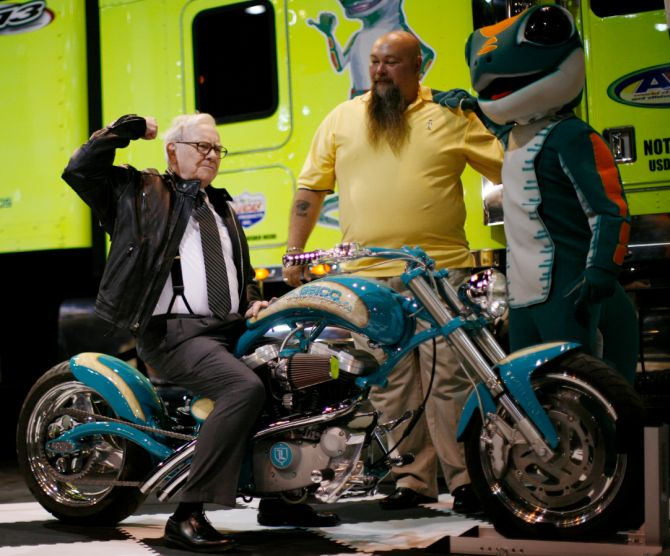 Billionaire financier and Berkshire Hathaway Chief Executive Warren Buffett poses on a motorcycle during the Berkshire Hathaway Annual Shareholders meeting in Omaha.